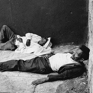 Two Men Asleep in an Empty Pool